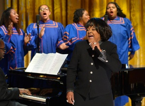 WASHINGTON, DC - APRIL 14: Pastor Shirley Caesar sings along with the Morgan State University Choir during an evening of Gospel music in the East Room of the White House, April 14, 2015, in Washington, DC. The entertainment, featuring music legends and contemporary artists is part of a 'In Performance at the White House' series. (Photo by Mike Theiler-Pool/Getty Images)
